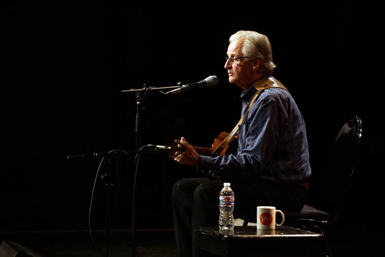 Geoff Muldaur ---- With just a guitar and a coffee cup and a chair this guy makes it all real ---- On his bi-annual swing through Albuquerque at Outpost Performance Space, October 5, 2o19 – photo by Mark Weber