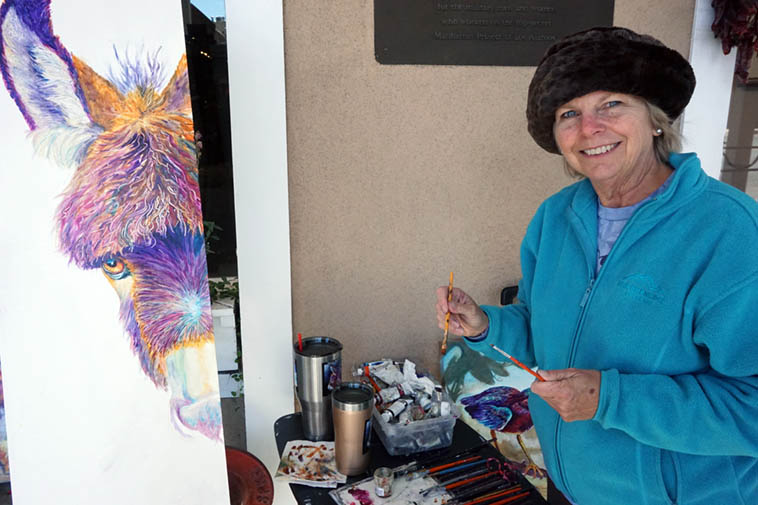 """Sharon Markwardt ---- her work is represented by Manitou Gallery, Santa Fe ---- We got to talking about how expensive tube paints have become, she joked """"That's why I paint so thin!"""" ---- photo by MW October 11, 2o19 on the sidewalk outside Manitou on East Palace Avenue"""