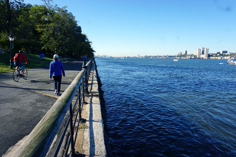 Janet walking along the quay ---- October 23, 2o19 10:24am (my wife is an exercise type, so I was tagging along) ---- Hudson River near 113th Street looking south from Manhattan – photo by MW