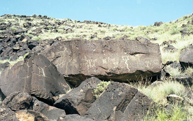 Petroglyphs of ancestral pueblo people on the West Mesa of Albuquerque ---- some of the petroglyphs date back 3,000 years ago but these are probably circa 1300AD in Rinconada Canyon ---- photo by Mark Weber September 21, 1991