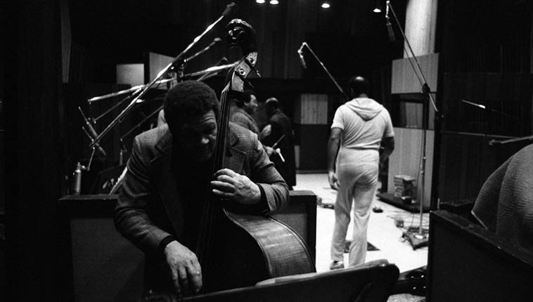 Bassist/composer/arranger Al Hines playing Henry Franklin's bass at the break during recording session for Robert Crowley's album ONE STEP OUT (Nimbus Records) (that's Henry in white walking to control room) ---- United-Western Studios, Los Angeles – January 27, 1981 ---- photo by Mark Weber