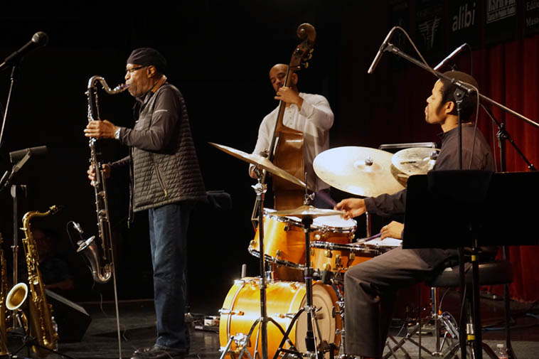 One of the greatest most soulful versions of Body & Soul was heard this night when Bennie picked up his tenor (I sure hope all those mikes means they were recording?) ---- a trio called Options: Bennei Maupin(woodwinds), Nasheet Waits(drums), Eric Revis(bass) ---- October 31, 2o19 – photo by Mark Weber