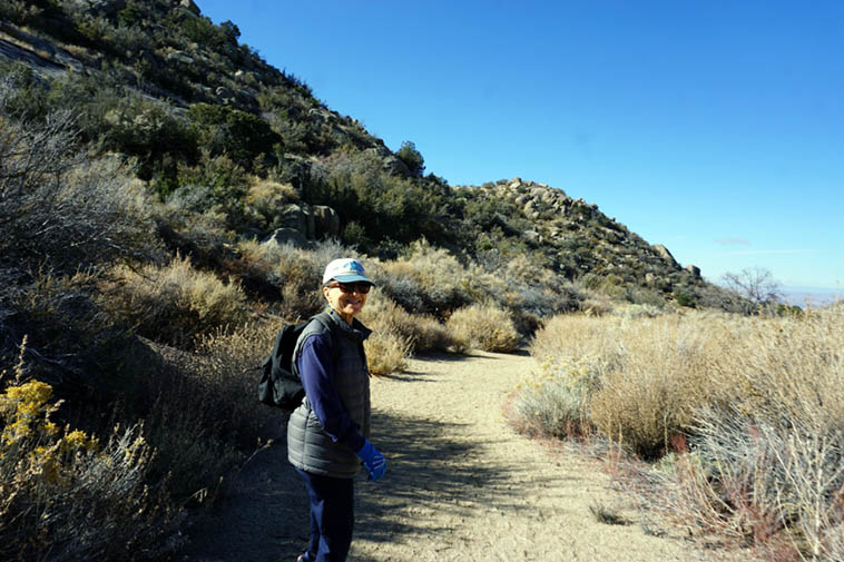 My dear Janet out for a walk in the Sandia Mountains foothills on a cold Saturday last November ---- photo by MW
