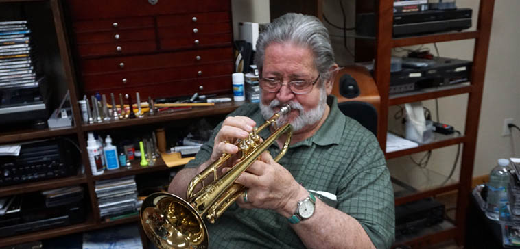 """Bobby Shew showing me Conrad Gozzo's old trumpet that he just had reconditioned ---- February 28, 2020 ---- Bobby says that whatever his legacy might be, it's his teaching that he's most proud of, and his theories on embouchure ---- That's all well & good, but Mr Shew's recordings are well worth investigating, he's a pure Lestorian story teller, he's got an old Scottish poet trapped inside him I always say, of which he always responds """"Irish"""" —- photo by Mark Weber"""