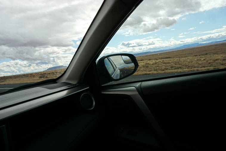 Shooting while driving ---- (not something I recommend or do, really ---- I prefer to concentrate on driving, but, I was out there by myself about 100 miles west of Albuquerque) -- November 20, 2019 ---- The good ol' shoot into a rearview mirror maneuver