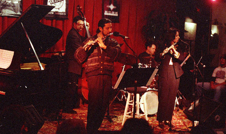Rudolfo Gonzales(flute) sits in with the Lisa Polisar Quartet: Lisa(flute), Jack Manno(piano), Michael Candito(drums), Tony Bellassai(bass) ---- when the Outpost Performance Space was on Morningside (they moved to present location in 2000) ---- photo by Mark Weber ---- December 7, 1998
