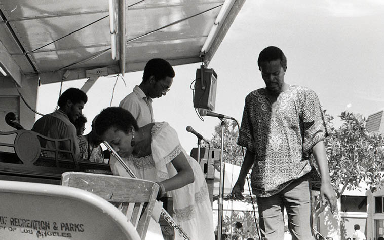 That's the two flutists Adele Sebastian and Aubrey Hart in the Pan Afrikan Peoples Arkestra with Horace Tapscott conducting ---- July 7, 1979 Watts Towers Festival ---- photo by Mark Weber