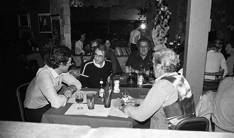 Dave Frishberg hanging out at Two Dollar Bills, Franklin Avenue, Hollywood, to see Joanne Grauer Trio ---- April 18, 1980 --- That's tenor saxophonist Bob Hardaway to Dave's left, and that's Al Cecchi and Wolfgang Melz of Joanne's trio ---- a rather paparazzi photo by Mark Weber