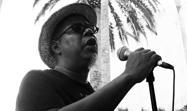 "Dwight Trible, current & longtime member of Pan Afrikan Peoples Arkestra ---- In this shot he's singing Bobby Bradford's lyrics to ""Goodbye Pork Pie Hat"" at LACMA Los Angeles Country Music of Art with Bobby's band Tete-a-Tete ---- August 14, 2015"
