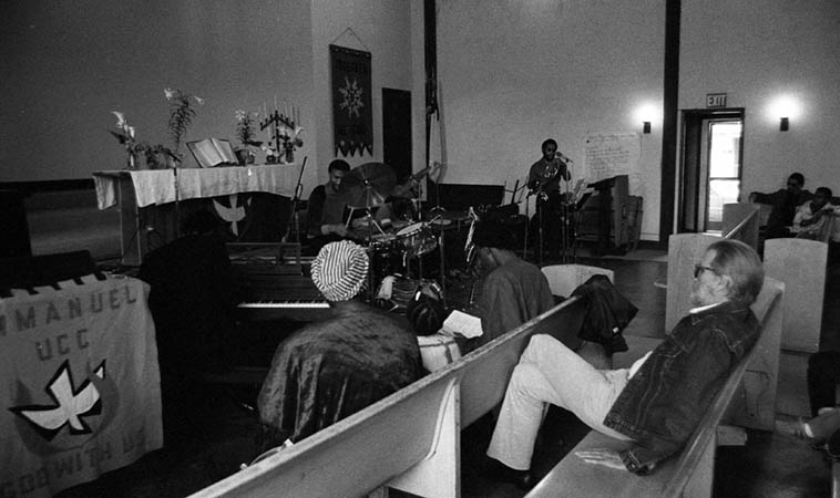 Pan Afrikan Peoples Arkestra ---- Fritz Wise(drums), Fundi LeGogn(French horn), Ufahamu Uweizi(alto), Tom Albach (Levi jacket) producer of Nimbus Records ---- April 26, 1981 ---- photo by MW