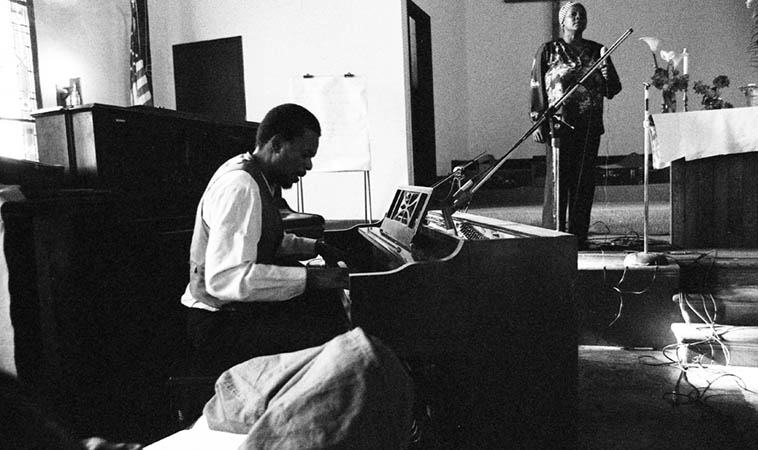 Horace Tapscott and Linda Hill and Pan Afrikan Peoples Arkestra at Immanuel Church of Christ, 85th & Holmes, Los Angeles ---- April 26, 1981 ---- photo by Mark Weber ---- I've been listening to a lot of PAPA lately, a pretty strong statement being made there, an indictment against injustice, economic push-down, hatred.