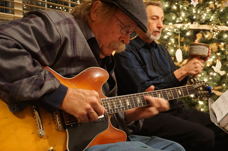 Two-thirds of a beloved Albuquerque outfit we call The Bobcats: Dan Dowling (guitar), and Bob Gusch (woodwinds) shaking down a Jobim tune at KUNM's Jonathan Longcore's (I.T.) retirement party December 8, 2018 ---- photo by Mark Weber