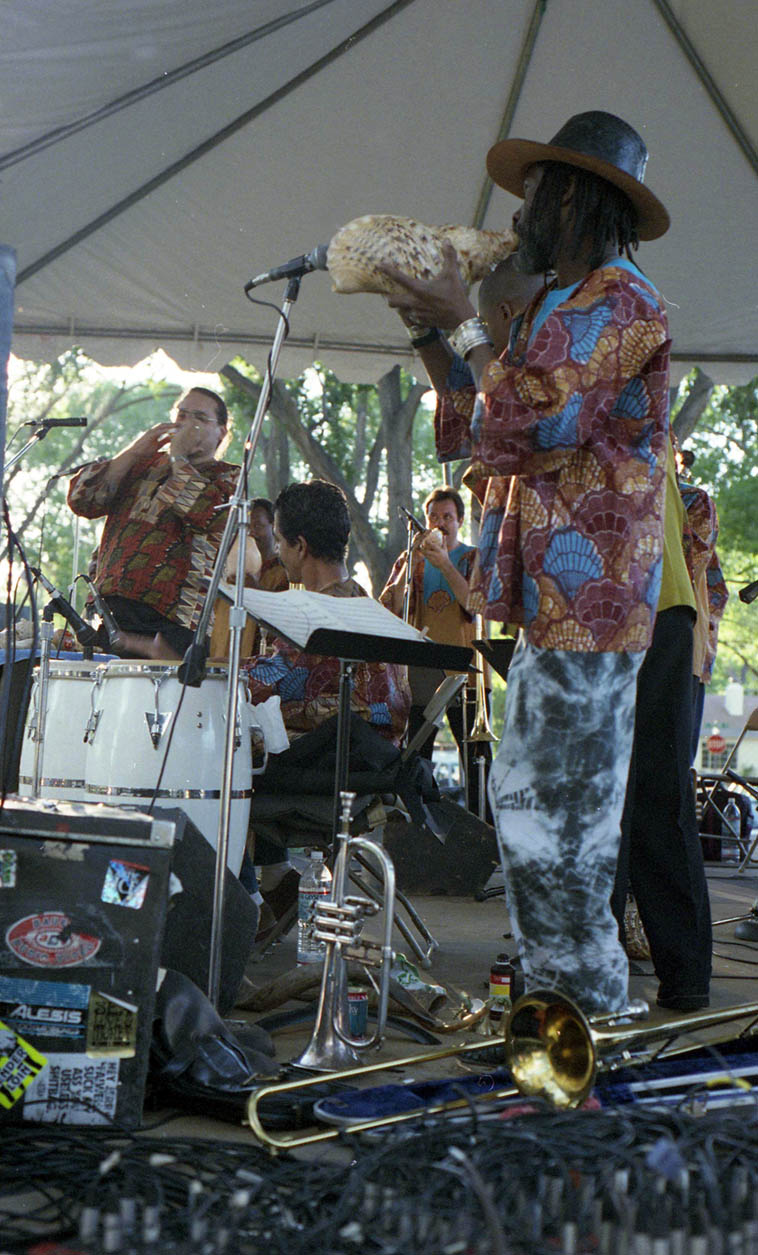 Steve Turre's Sanctified Shells ---- Bataan Park, Albuquerque ---- September 10, 1995 ---- photo by Mark Weber ---- that's trombonist Frank Lacy with conch ---- a totally tremendous band