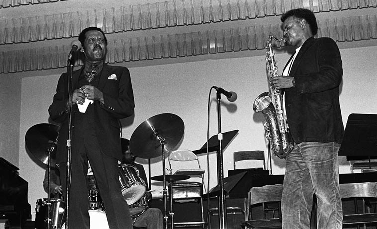 Ernie Andrews and Plas Johnson at the Dolo Coker Love-In benefit Local 47 Los Angeles March 20, 1983 (Dolo dies April 13 of cancer) ---- Sherman Ferguson(drums), Frank De La Rosa(bass) ---- photo by Mark Weber