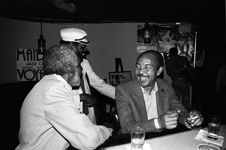 2 trumpeters & a saxophonist: Freddie Hill (silver hair) & Martin Banks (hat) w/ Harold Land at Maiden Voyage during Harold's afternoon rehearsal ----May 10, 1981 ---- photo by Mark Weber