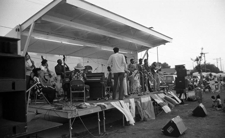Pan Afrikan Peoples Arkestra at Watts Towers Jazz Festival ---- July 11, 1981 ---- Linda Hill on piano with Horace out front and Adele seated behind Linda ---- photo by Mark Weber