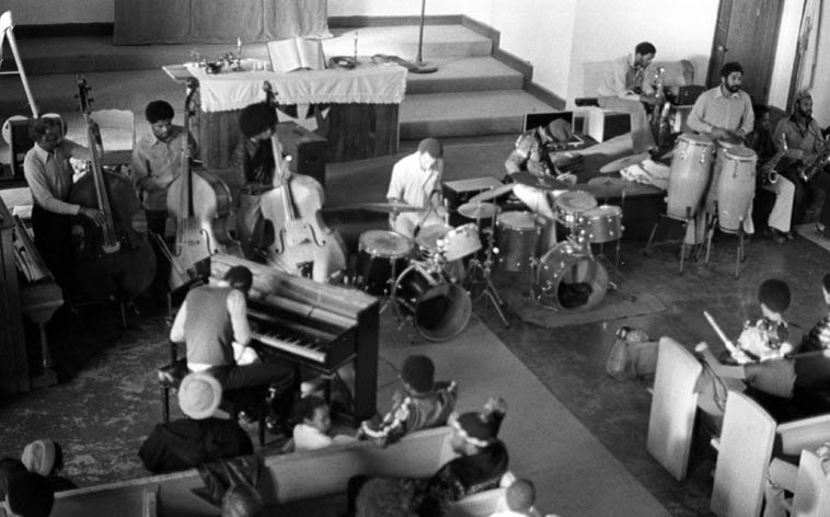 Pan Afrikan Peoples Arkestra ---- I see David Bryant the furthest left of the 3 bassists, Linda Hill sitting with children (white hat) in front row behind Horace at piano, Billy Hinton & James Madison on drumsets, and Moises Obligacion, conga ---- January 30, 1977 ---- photo by Mark Weber