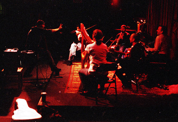 Out of Context in performance at Outpost Performance Space ---- November 21, 1997---- Alicia Ultan(viola), Tom Guralnick(soprano saxophone), Mark Weaver(tuba), Jefferson Voorhees(drumset), Courtney Smith(harp), J.A. Deane conduction ---- photo by Mark Weber