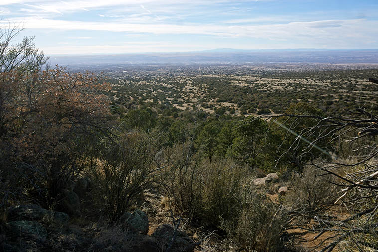 "About dead center of this photo is where the ""Five Stones"" are in attendance ---- photo by Mark Weber looking toward Albuquerque and Rio Grande, February 8, 2021 and Mt Taylor sixty miles in distance"