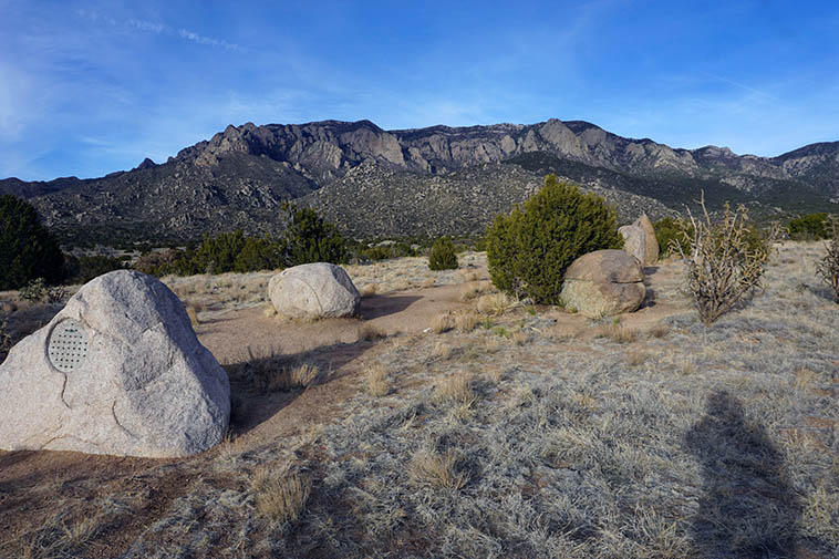 """Five Stones for Elena Gallegos"" (1983) by Billie Walters at the mouth of Pino Canyon, Sandia Mountains ---- photo by MW 4:28pm February 8, 2021 and my shadow"