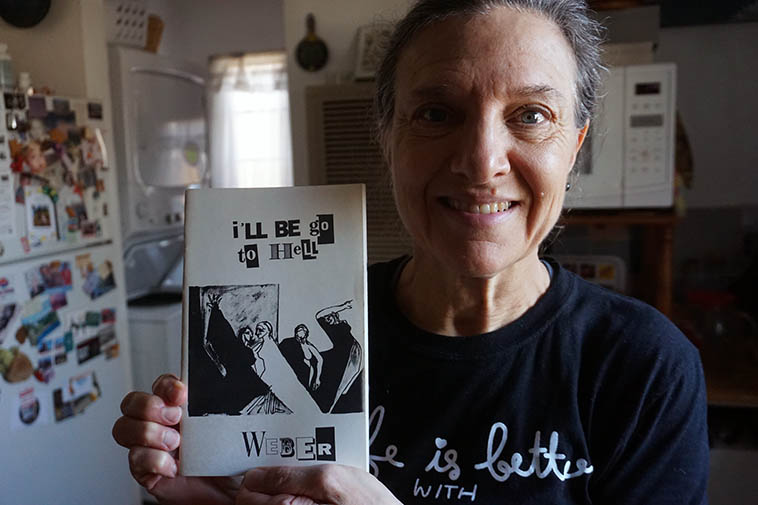 Janet with chapbook by yours truly, subtitled: A story, a book review, some drafts, and some poems (1997 Zerx Books) cover designed by Robert Walters ---- photo by MW Feb. 2021