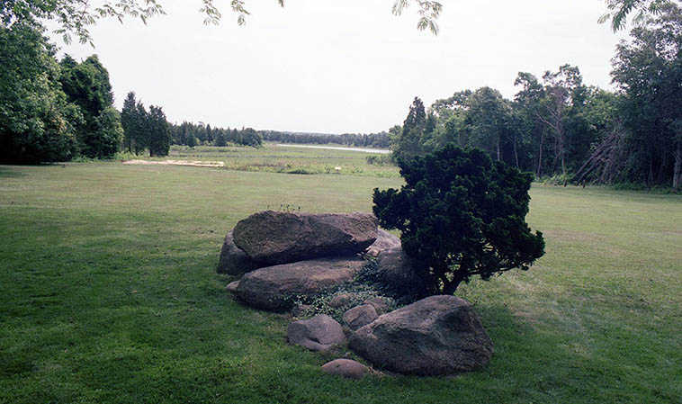 """View out back door of Jackson Pollock & Lee Krasner's home on Fireplace Road in Springs, Long Island (Hamptons) ---- July 1, 1995 photo by Mark Weber ---- Those were rocks Jackson placed in that arrangement ---- These rocks are here & there all around that part of Long Island left-over from the great ice sheets of the last Ice Age, what the geologists call """"glacial erratics"""""""