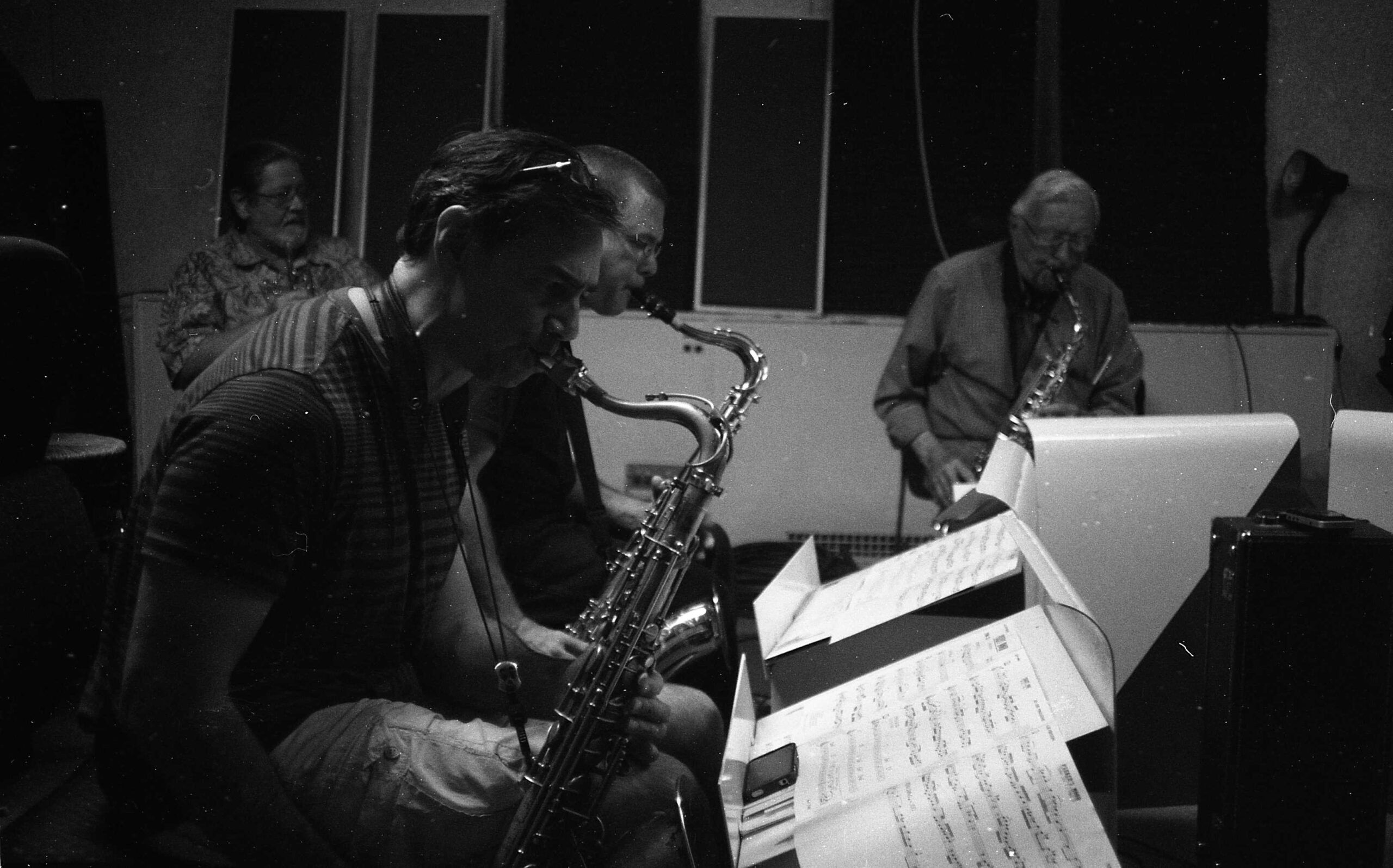 The five saxophones that were SuperSax New Mexico in the studio at KUNM ---- Kanoa Kalihiwa, Lee Taylor, Arlen Asher, Dave Anderson, Glenn Kostur (saxophones), Bert Dalton(piano), Michael Glynn(bass), Cal Haines(drums), Bobby Shew(trumpet soloist) ---- Reading down the charts of the 1970 Los Angeles ensemble Supersax ---- Photo by MW May 15, 2011