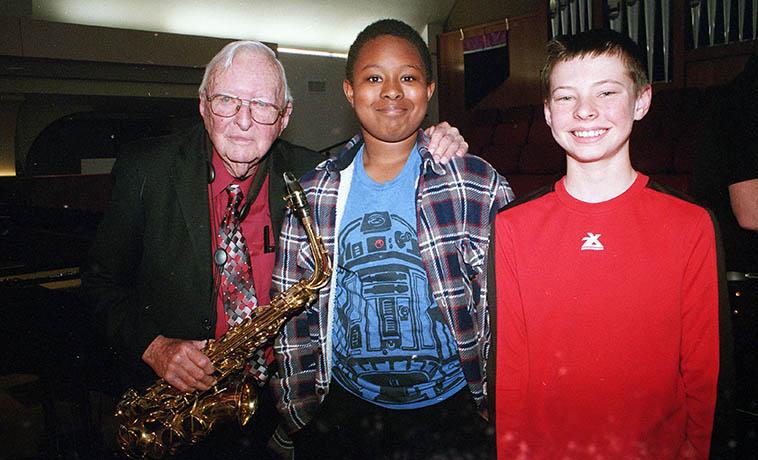 Concert at St John's of Arlen Asher Quartet ---- Those kids asked if I'd take a photo of them with Arlen ---- the kid in the middle is singer Michael Herndon's boy and the kid in red is the grandson of author Todd Moore ---- Deejdrick Herndon and Jacob Moore, who are school chums ---- Jacob sat with us and I was impressed by how attentive he was to the music through two entire sets he was transfixed, which means he must be a musician, I think Barbara said he's already on the saxophone ---- March 4, 2018 photo by MW