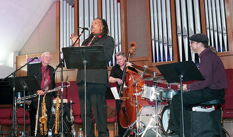 """Arlen Asher Quartet with guest Michael Herndon at St John's United Methodist Church, Albuquerque ---- March 4, 2018 --- John Blackburn(bass) Arlen (woodwinds), John Bartlit(drums), Jim Ahrend(piano) ---- photo by MW ---- Michael sang """"Honeysuckle Rose"""" while the quartet played """"Scrapple from the Apple"""" ------- In Arlen's opening remarks to this concert he told us that his very first gig was in a saloon on December 6, 1941 (by my calculations he was 12 years 7 months) """"the day before the Pearl Harbor attack,"""" which got his career off to a bang ----- John Blackburn harkens back to Arlen's 1979 album (Lp vinyl) MUSIC IS FOR SHARING, so, he's been with Arlen forty-plus years!"""